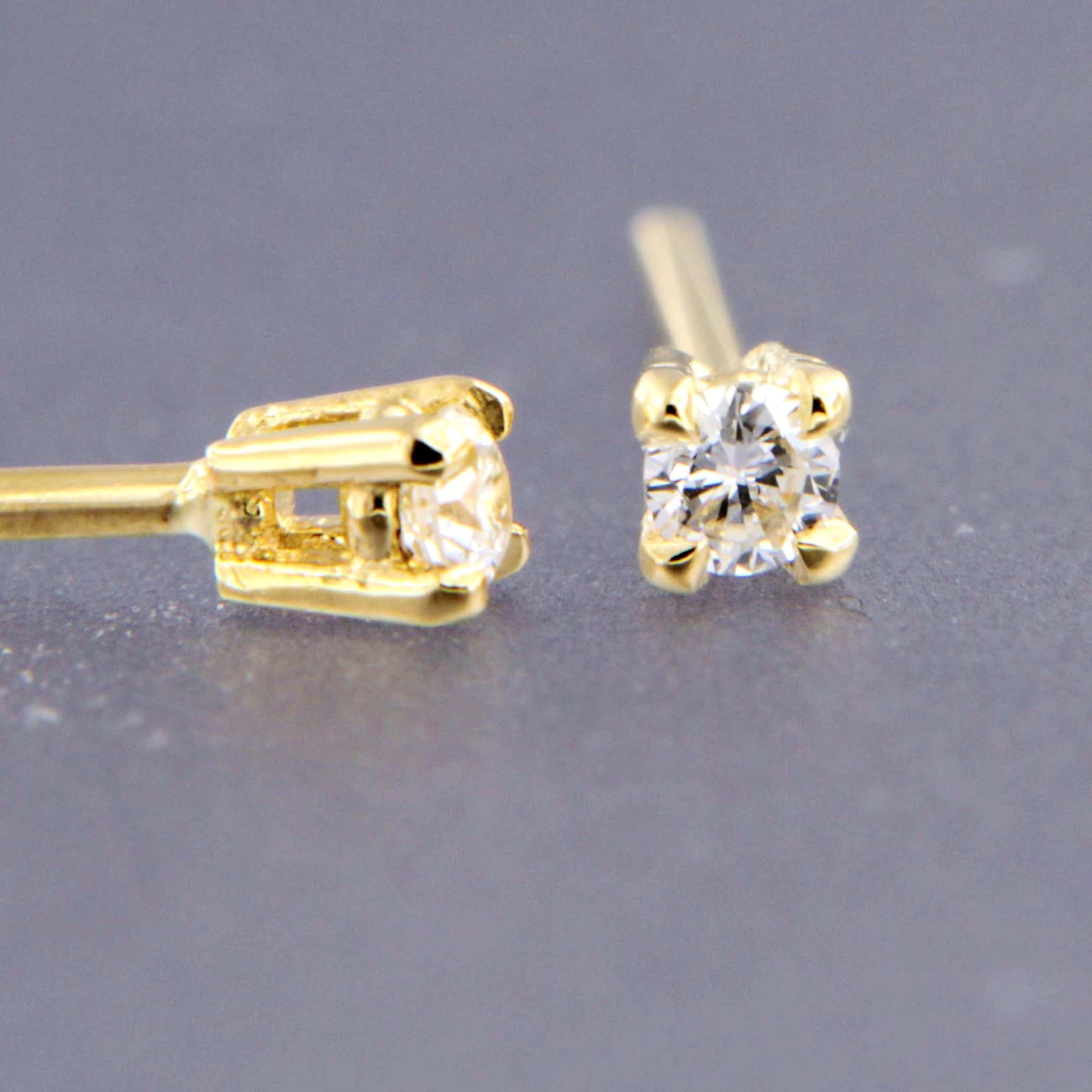 14K Goud - geelgouden solitair oorstekers met briljant geslepen diamant kopen? Bied vanaf 150!